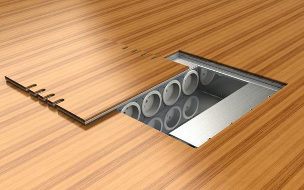 Díky překrytí víka potřebnou krytinou se stane podlahová zásuvka v interiéru téměř neviditelná