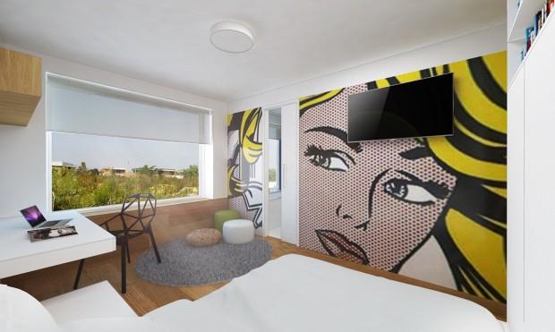 Pokoj zatepluje dřevěná podlaha – využili jsme ji i jako obklad stěny, který sahá až po okenní parapet. V této výšce se táhne i za postelí, kde přebírá úlohu čela postele. Grafika tapety inspirovala tvůrce návrhu i při výběru židle, která interiér výborně doplňuje a oživuje svým zajímavým designem. Na stínění vybrali roletku – je výhodná pro snadnou manipulaci, textilie zároveň změkčuje a protepluje prostor.