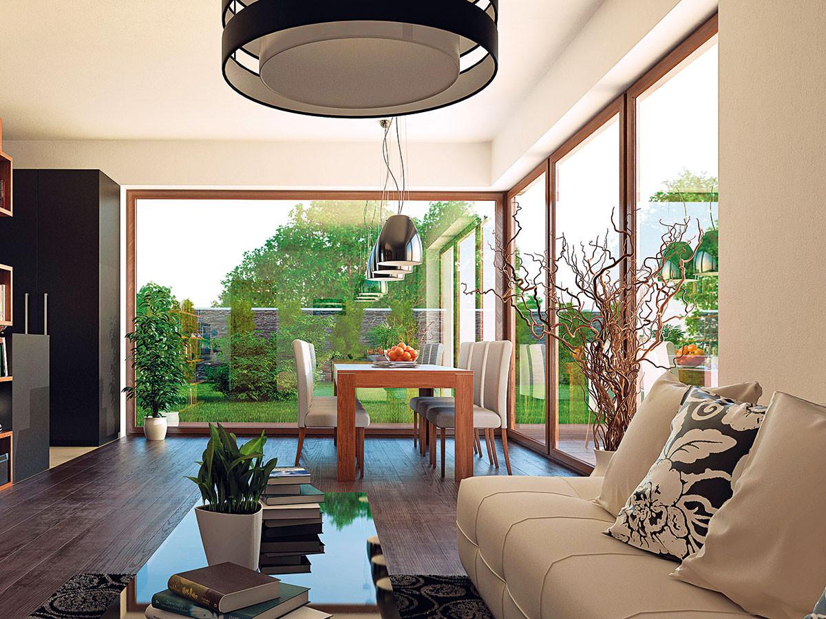 Obývací pokoj - přibližně třetina obvodu pokoje je prosklena aotevírá se tak do zahrady. OBRÁZKY EKONOMICKÉ STAVBY