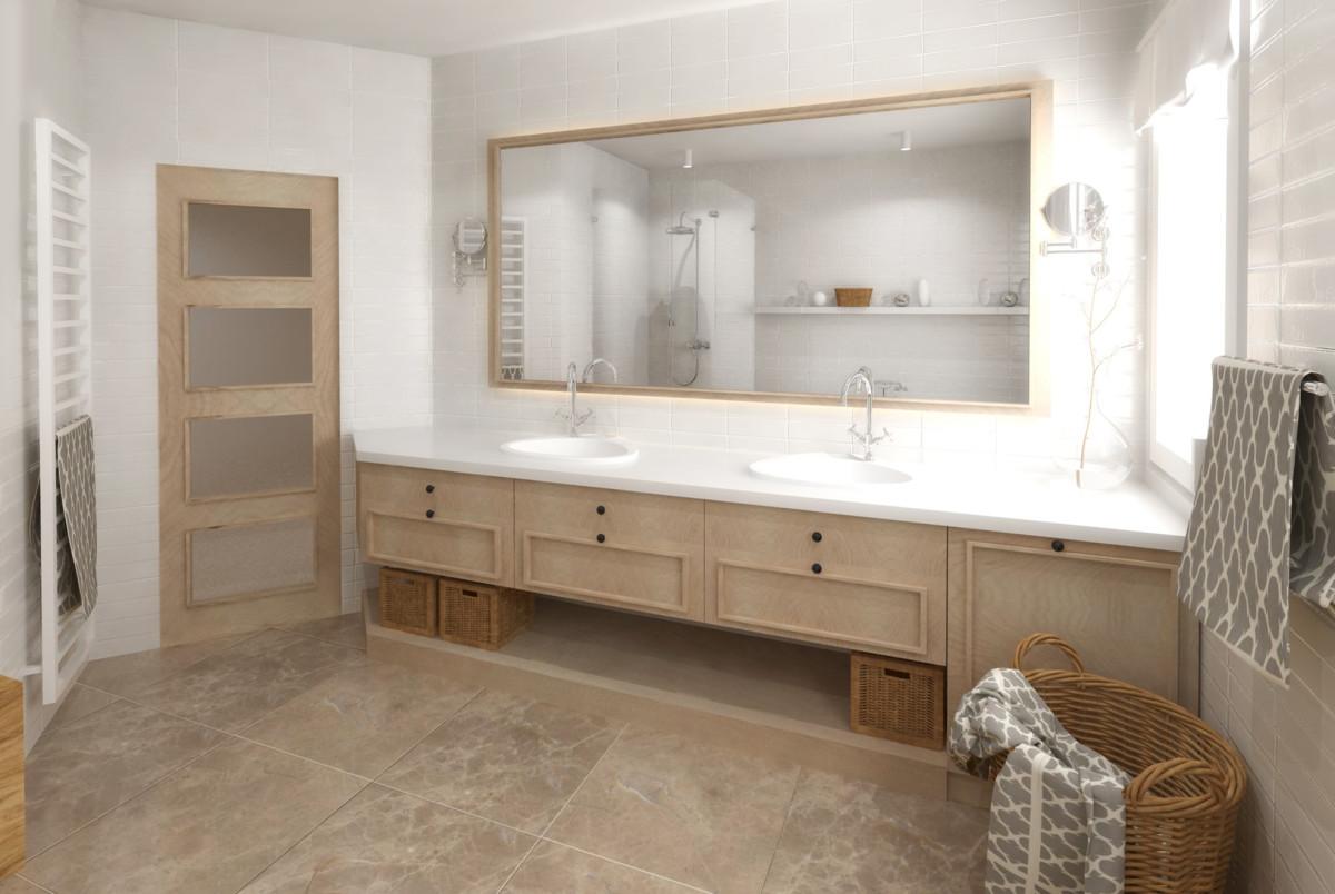 Skříňka s umyvadly dlouhá tři metry poskytuje dostatek úložného prostoru, i když první zásuvky musí být kvůli umístění umyvadel mělčí. Zrcadlo je zezadu podsvícené, což i díky cihlovému obkladu dodává stěně plasticitu. Příruční zrcadélka na každé straně je praktické namontovat podle skutečné výšky majitelů. Pračka zabudovaná hned pod oknem úplně splyne se skříňkou.