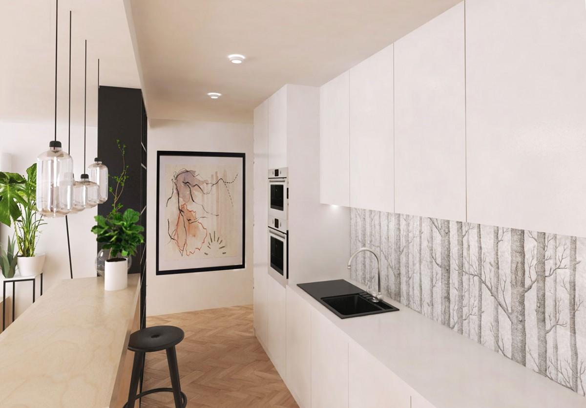 Kuchyňskou zástěnu tvoří transparentní kalené sklo. Je skrze něj vidět tapetovanou stěnu, která plynule pokračuje na stěně v chodbě. Tím je kuchyňská linka více propojena se zbytkem bytu. Nábytek na míru je navržen v bílé barvě na docílení většího splynutí s bílými stěnami. Kuchyňská linka naplno využívá úložného potenciálu až do výšky stropu. NÁVRH LUCIA KUŠNÍROVÁ