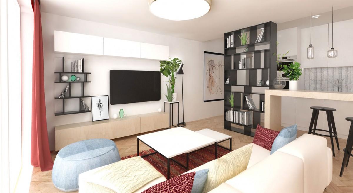 TV stěnu tvoří dvě uzavřené skříňky a mělká vitrína s rastrem shodným s knihovnou, která odděluje kuchyň od obýváku. NÁVRH LUCIA KUŠNÍROVÁ