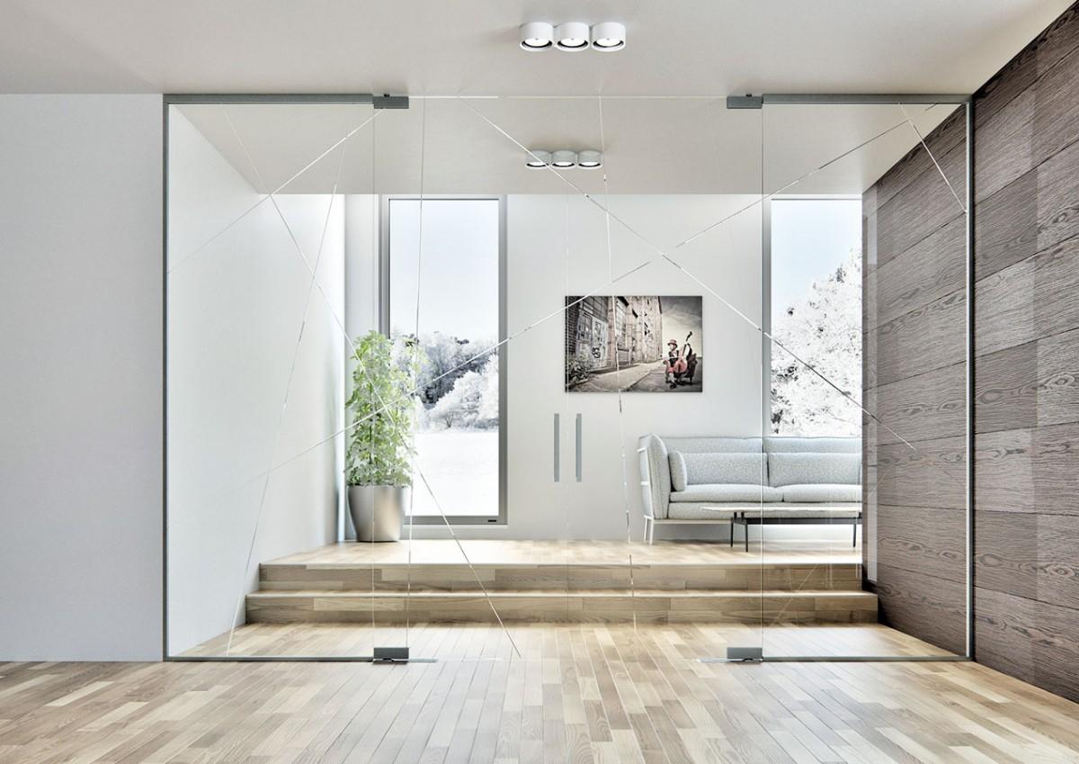 Otevírání prostor. Velkým trendem soudobých interiérů jsou otevřené, vzdušné prostory. Proto stále častěji architekti adesignéři sahají po velkých dvoukřídlých posuvných dveřích avolí transparentní materiál, kterým je sklo. Této tendenci vycházejí vstříc ičeští výrobci dveří. FOTO SAPELI
