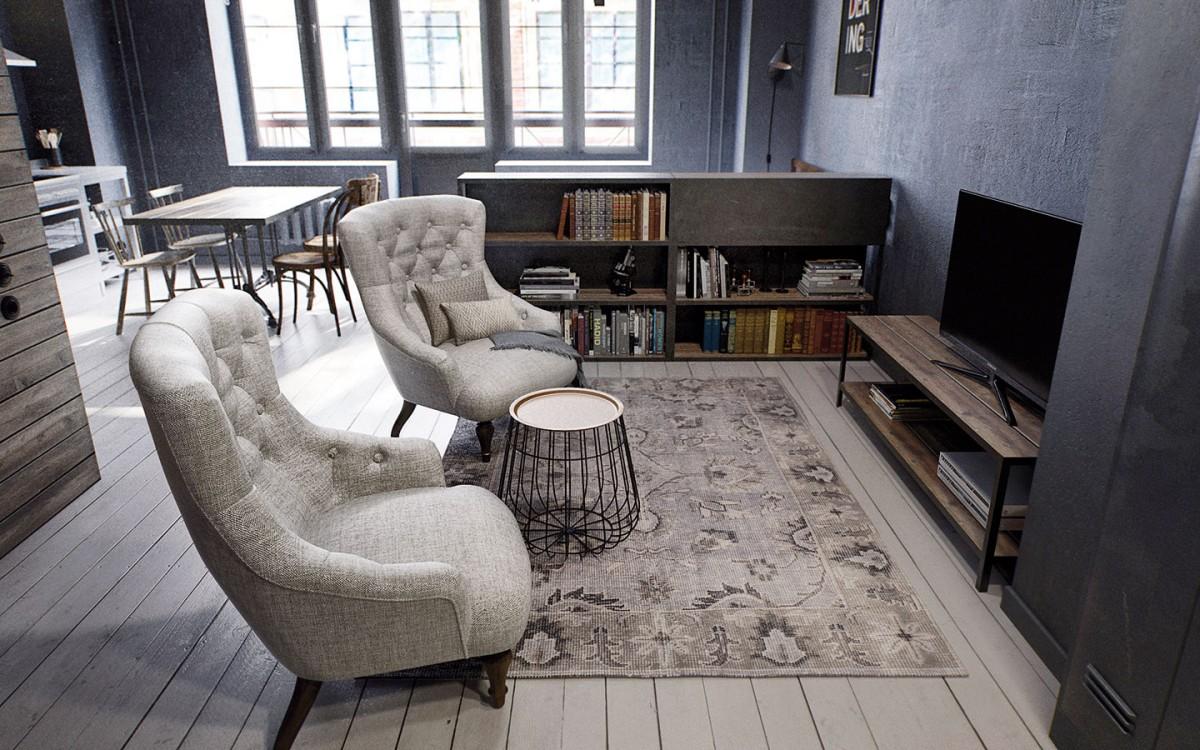 """Obývací kout je možná trochu netradičně umístěn hned za vstupním prostorem. Od """"ložnice"""" ho odděluje nábytková polopříčka, která v prostoru obýváčku plní funkci knihovny a u postele zase slouží jako odkládací a noční stolek. FOTO INT2ARCHITECTURE"""