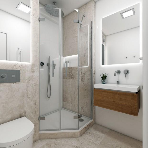 Moderní koupelna Mini využívá klasického optického efektu světlých ploch. Fádnost bílé doplňují světle šedé dlaždice z kolekce Blend, připomínající beton původních, starých konstrukcí. Asymetrický tvar koutu přidal centimetry pro pohodlné sprchování. FOTO PERFECTO DESIGN