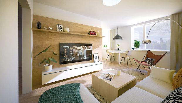 TV stěna na pozadí přírodního dřeva má prostor zútulnit. Aby působila vzdušněji, úložné prostory jsou navrženy jako zavěšené aodsazené od obou stran.