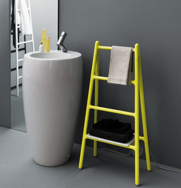 V jednodušší koupelně se určitě nemusíte bát i některého výraznějšího prvku, nebo barvy. Příkladem je stylový žlutý radiátor Tubes, který svým tvarem nepřipomíná žebřík, ale rovnou štafle. FOTO TUBES