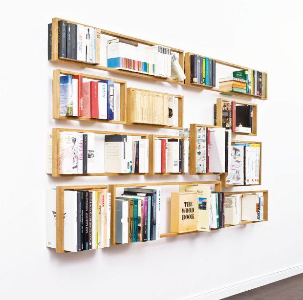 """I z jednoduchých dřevěných """"rámečků"""", poskládaných dle libosti a přivrtaných do zdi, si lze vytvořit originální knihovnu.FOTO BONAMI"""