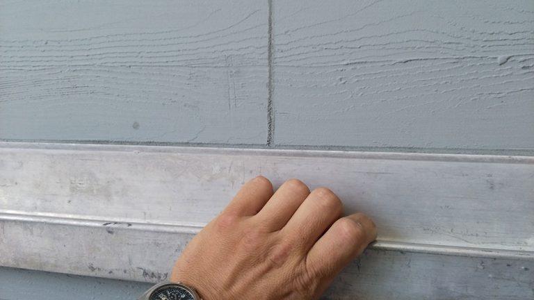 Fasáda s imitací dřeva na projektu horských apartmánů