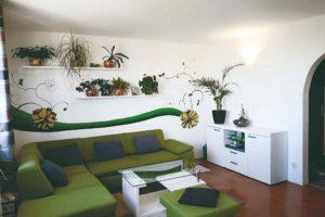 Obývák květinové nálepky zelená pohovka
