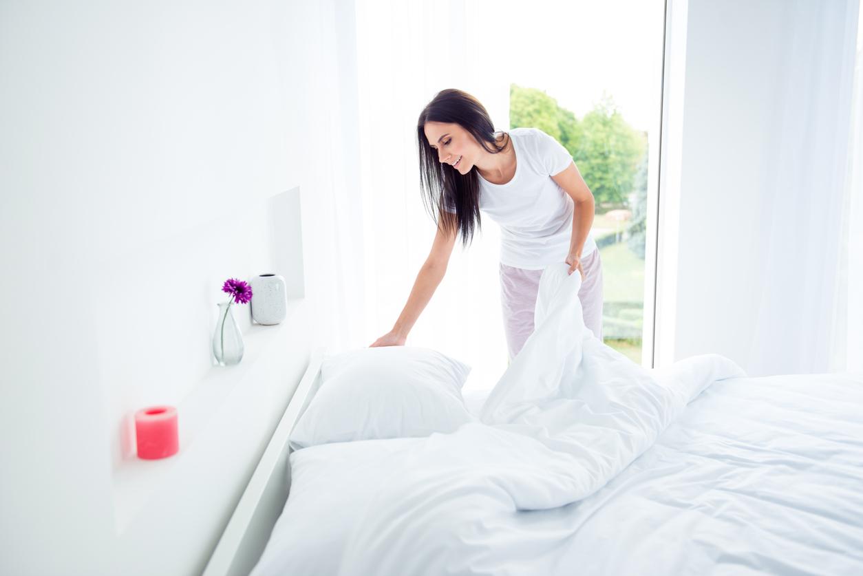 Žena s ložním prádlem