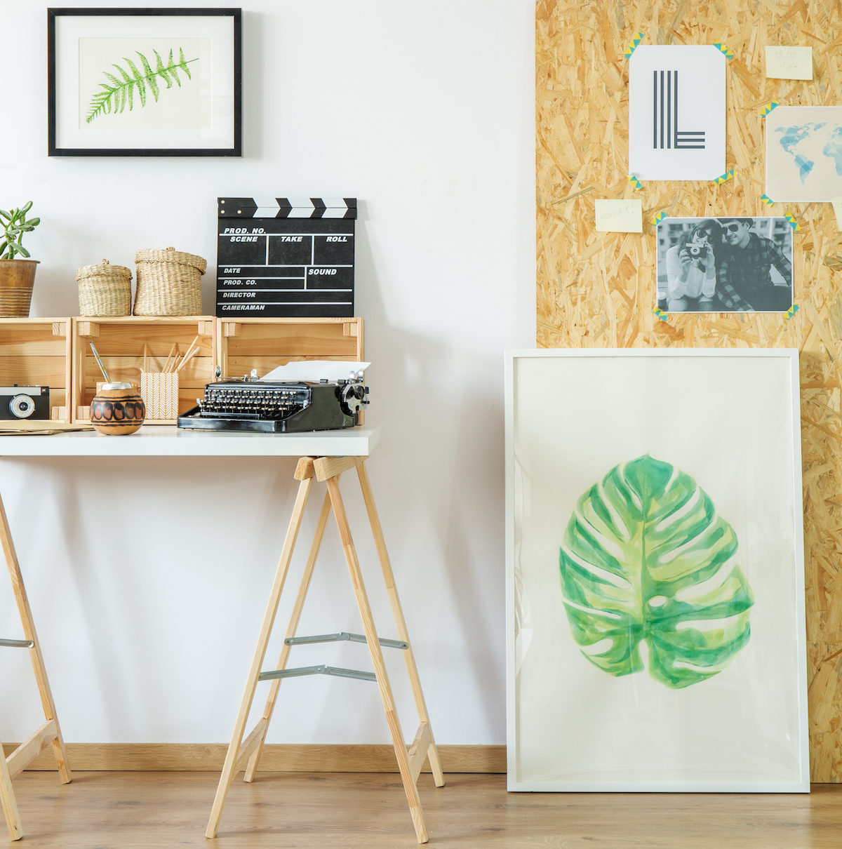 Artist's,Workspace,With,Simple,Wooden,Furniture,And,Paintings