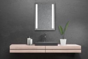 Dizajnové dřevěné umyvadlo v černé koupelně