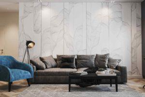 Obývací pokoj s velko šedou pohovkou a tyrkysovým křeslem